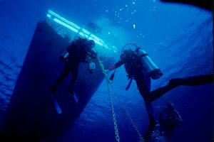 Divers under the boat
